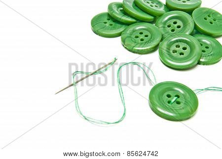 Green Thread And Buttons On White