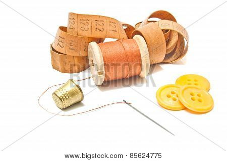 Spool Of Thread, Meter And Yellow Buttons