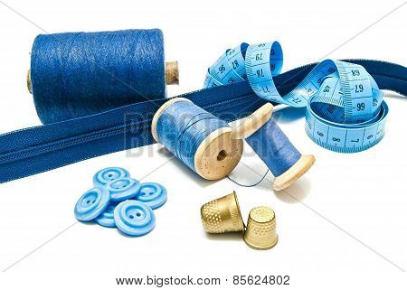 Blue Zipper, Buttons And Spools Of Thread