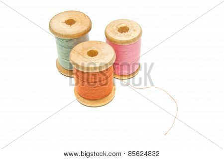 Three Wooden Spools Of Thread