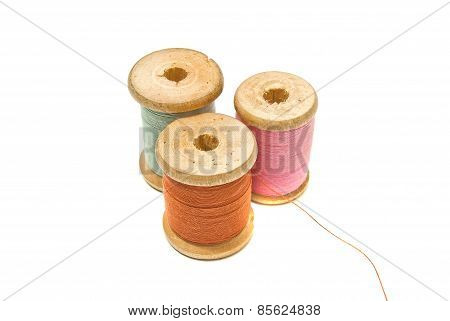 Three Spools Of Thread On White