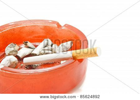 Single Cigarette In Red Ashtray