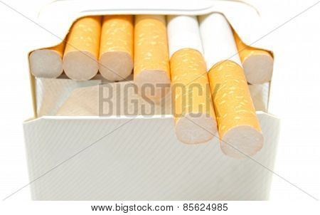 Some Cigarettes In Pack On White