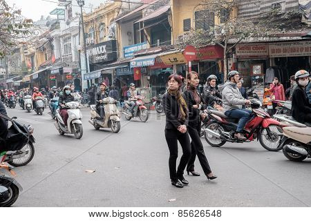 Crossing streets in Hanoi