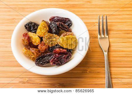 Mix Raisins On The White Dish