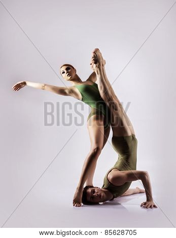 Couple of gymnasts isolated on white