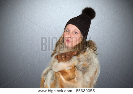 Beautiful woman with wool hat and gloves is dressed warmly