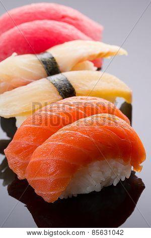 Sushi Nigiri Set On A Stone Plate Over Black Background