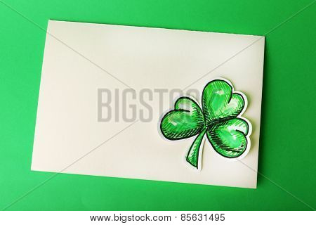 Greeting card for Saint Patrick's Day with shamrock on green background