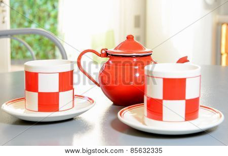 Teapot And Tea Cups On A Gray Table