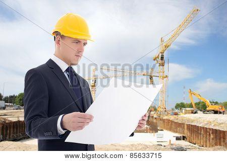 Handsome Architect Man In Builder Helmet At Construction Site