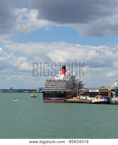 Queen Victoria cruise ship at Southampton Docks England UK in summer on calm day with blue sky