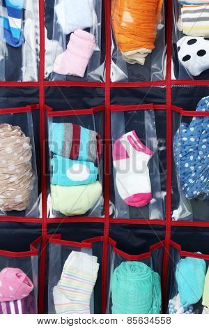 Different socks in hanging bag, closeup view