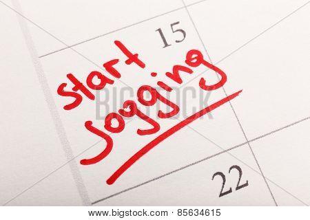 Written plan Start Jogging on calendar page background