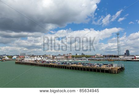 View of Southampton Docks with cars and cargo on a jetty on a calm summer day with fine weather