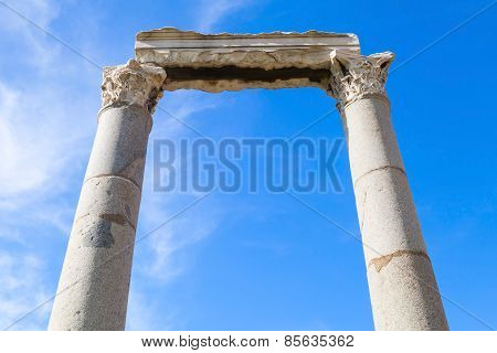 Two Columns And Portico Fragment On Blue Sky Background