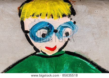 painting on the wall of a school. portrait of a child.