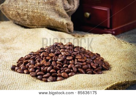 Coffee Beans, Hand Grinder On Sacking In Vintage Grunge Style. Selective Focus