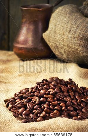 Coffee Beans, Coffee Maker On Sacking In Vintage Grunge Style. Selective Focus