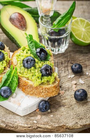 Sandwiches with avocado, blueberries and spinach