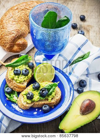 Toasts with blueberry and avocado cream