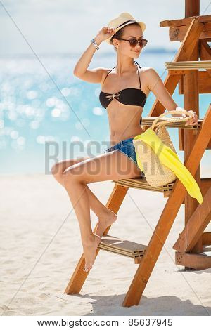 Portrait of a beautiful woman on a tropical beach.