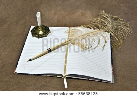 Beautiful Opened Journal With Feather Pen