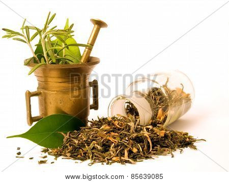 Pestle, herbs and pharmacy bottle.