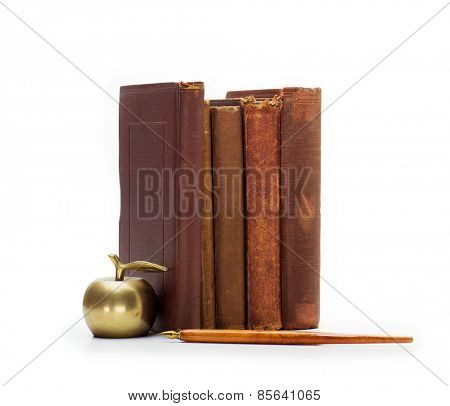 Old books and pen isolated on white.