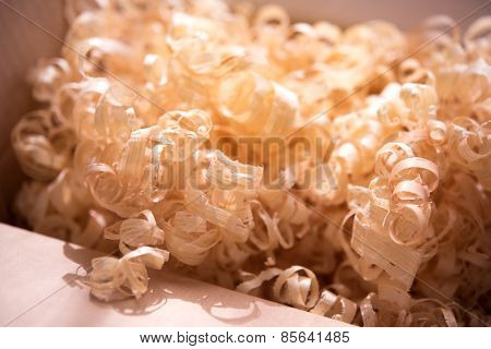 Wood shavings in a carton box. Intentionally shot in low saturation in-memory like tone.?Shallow depth of field.