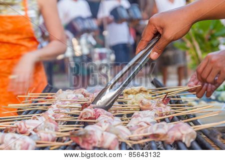 many prawns in bacon bbq sticks on grill, outdoor, summer bbq time