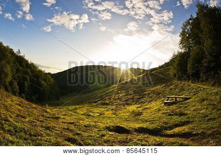 Autumn sunrise at mountain meadow