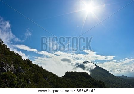 Mountain peaks of Suva Planina at morning covered with clouds