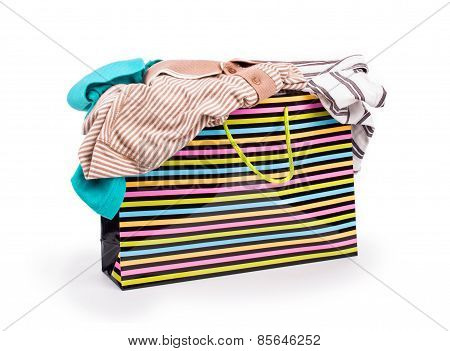 T-shirts In Shopping Bags On A White