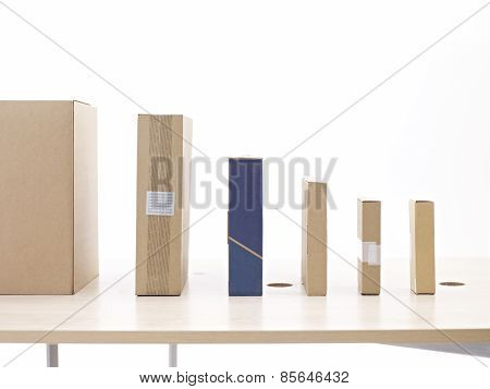 Packages lined up on table