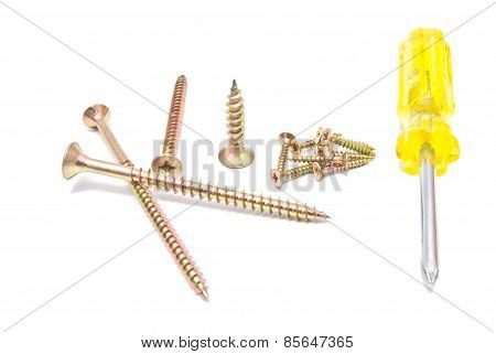 Golden Screws And Yellow Screwdriver On White