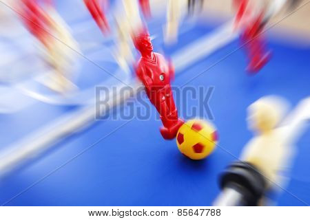 Foosball player.  Motion blur