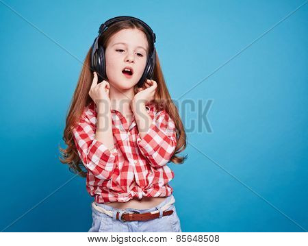 Thoughtful girl with earphones listening to music