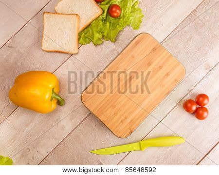 Healthy breakfast with  tomatoes and salad on white wooden table with copy space