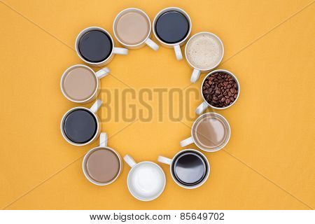 Coffee Cups Arranged In Circle Isolated On Yellow