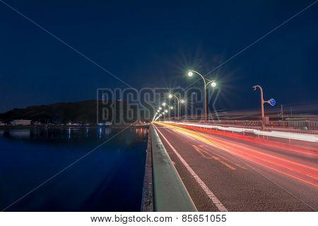 Cars Passing on Bridge