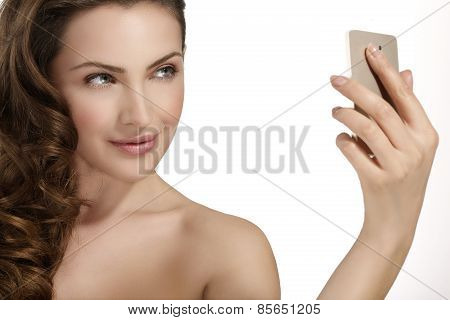 Beautiful Woman Take A Smiling Selfie With Smartfone
