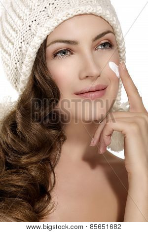 Beautiful Model Applying A Creme On Face Protection From Winter Cold