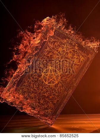 Leather Book in flames With Pentagram