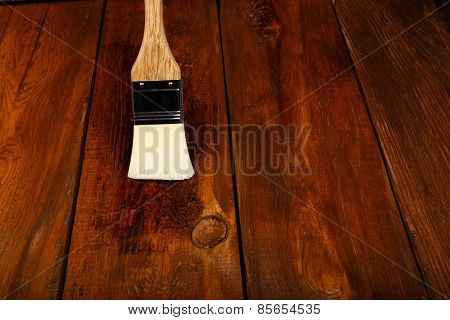 Applying Protective Varnish On A Wooden Table