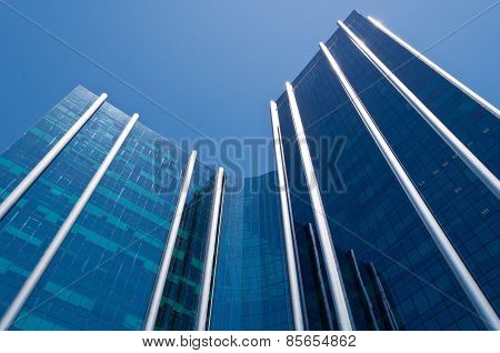 Modern Blue Business Building Against Clear Sky