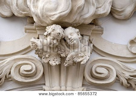 GRAZ, AUSTRIA - JANUARY 10, 2015: Angels on the portal of Mariahilf church in Graz, Styria, Austria on January 10, 2015.