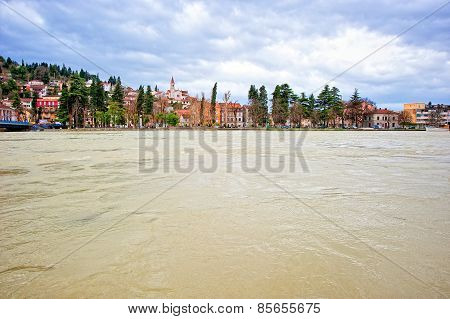 Small Mediterranean Town Along The Swollen River And Threatening Flood