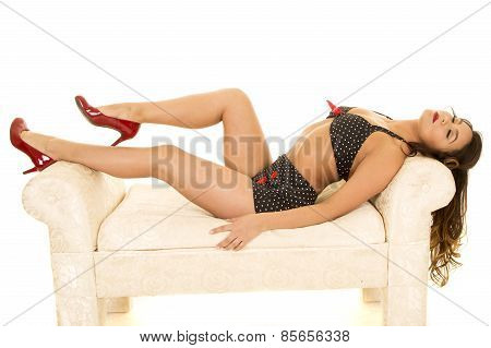 Woman In Vintage Bikini Lay On Couch Eyes Closed