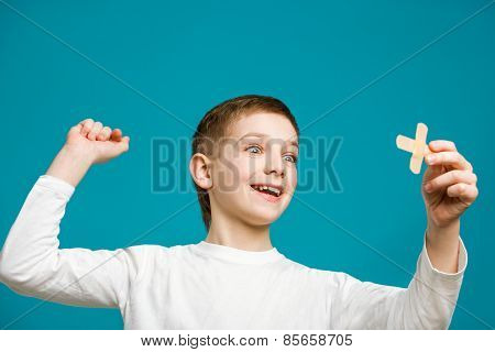 Happy Boy With Adhesive Plaster Cross In His Hand